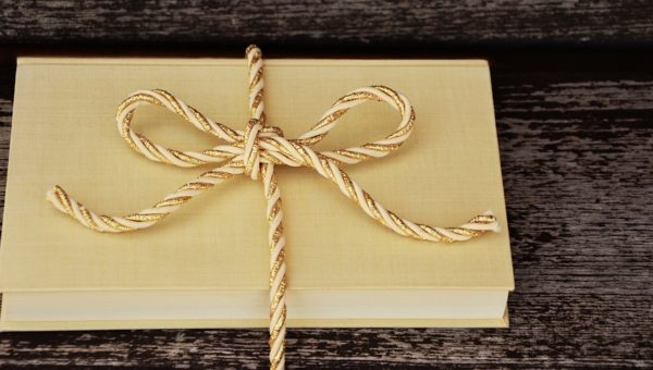 bookgift on the wooden table | Lift Legal