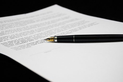 sign agreement pen | Lift Legal