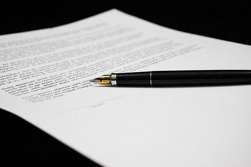 sign agreement pen | Lift Legal